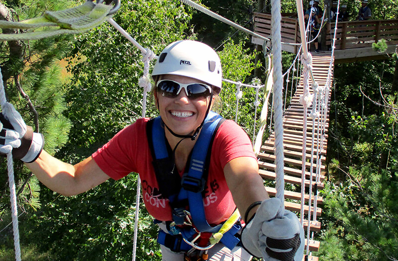 Girl walks across suspension bridge
