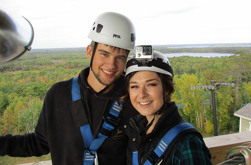 Couple poses for image during brainerd zipline tour