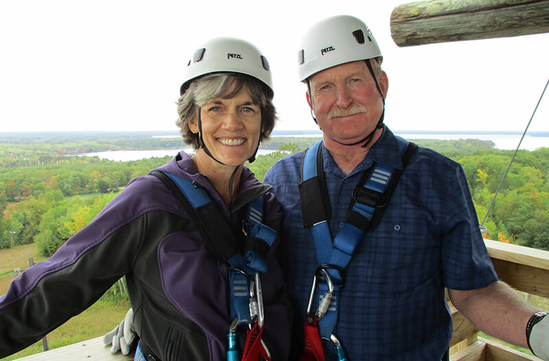 Couple poses for picture during brainerd zipline tour
